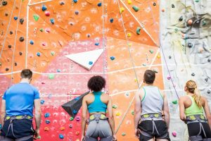 friends_rock_climbing_together